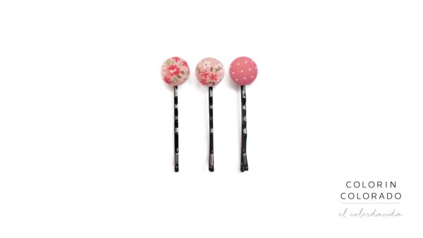 Pins with flowers and green leafs on pink